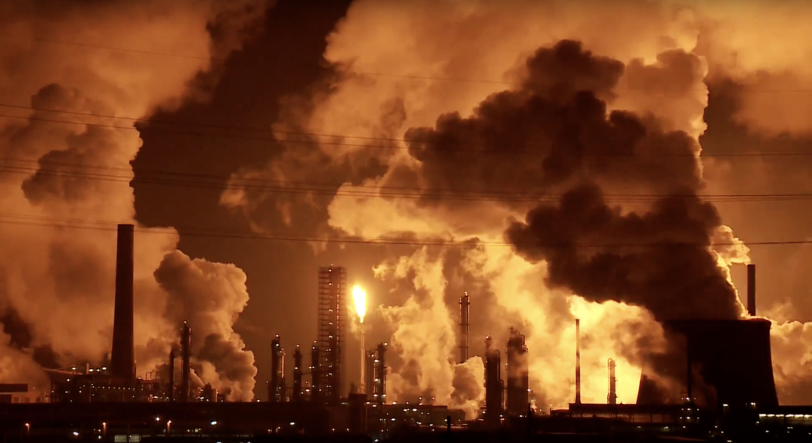 This is a picture of an oil refinery at night.